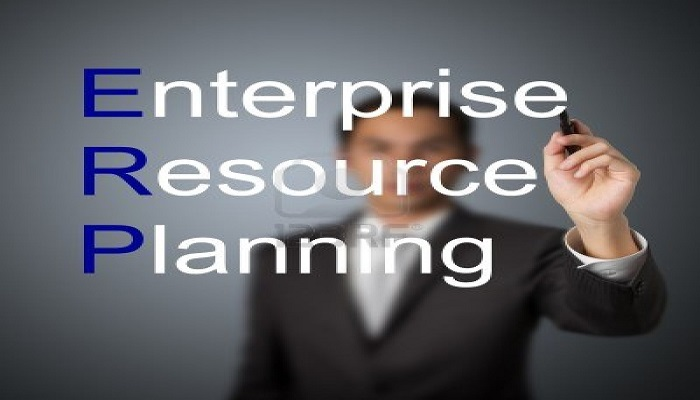 13241801-businessman-writing-enterprise-resource-planning-erp-system-concept-for-supply-material-management-b